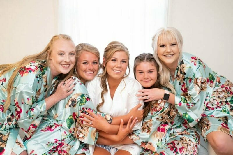bride and bridesmaids in robes with floral pattern