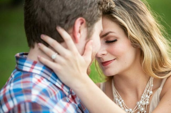 engagement photo with ring hand behind head