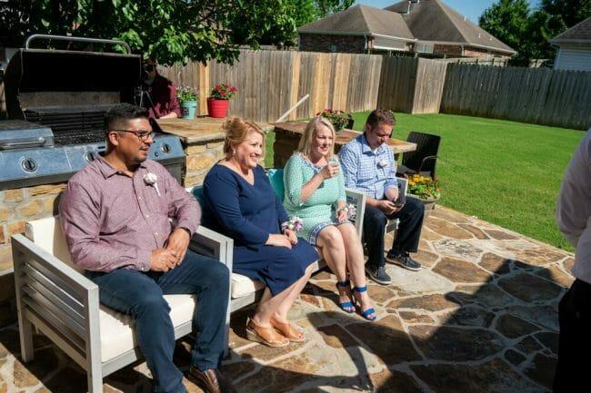 family watching backyard wedding