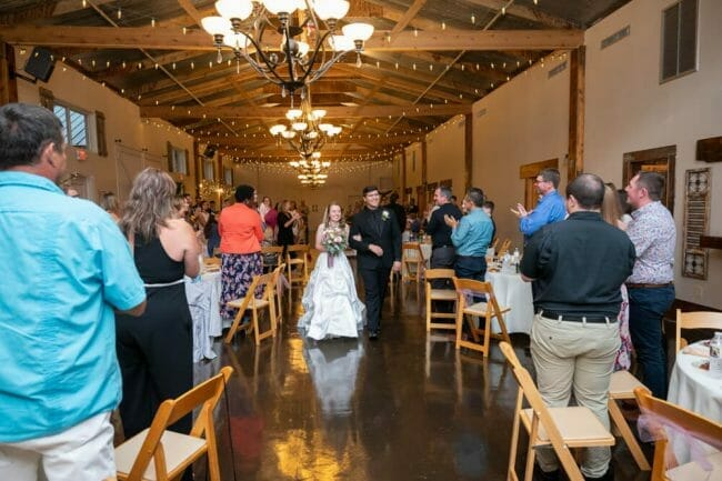 indoor wedding ceremony at barn at the springs