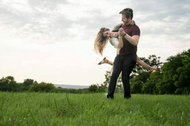 couple spinning in a field