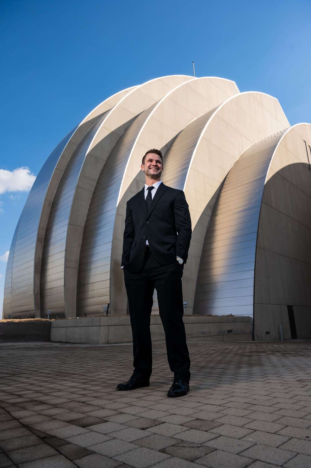 Kansas City wedding with groom in front of Kauffman Center