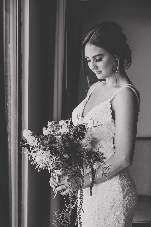 Kansas City bride with flowers in window light
