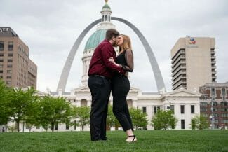 engagement photo at Kiener Plaza in front of St. Louis Arch