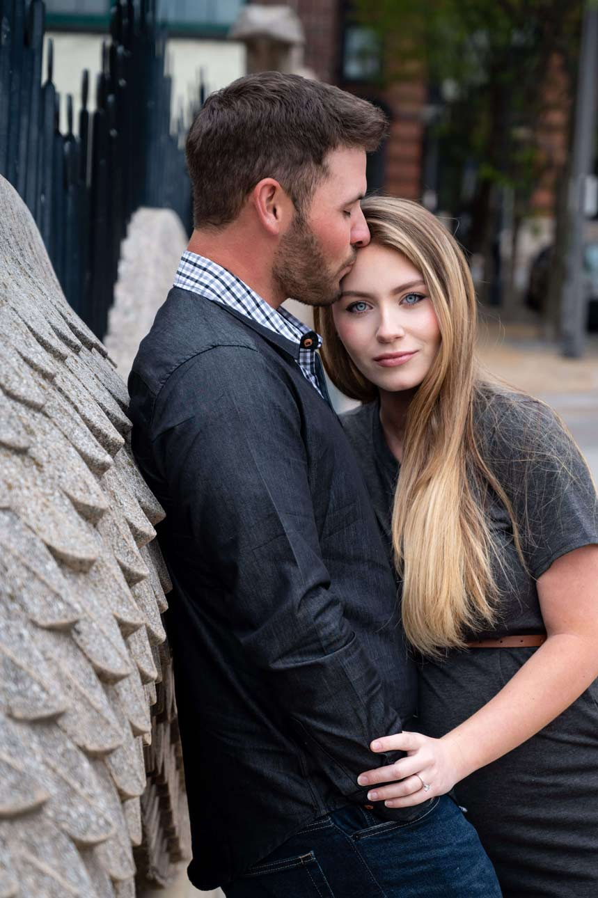 engagement photo in front of wall at City Museum in St. Louis