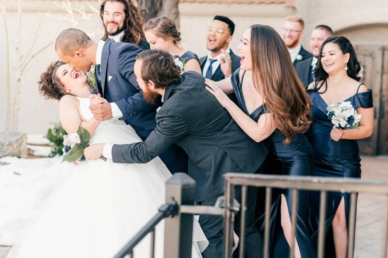 reactions as group hugs couple