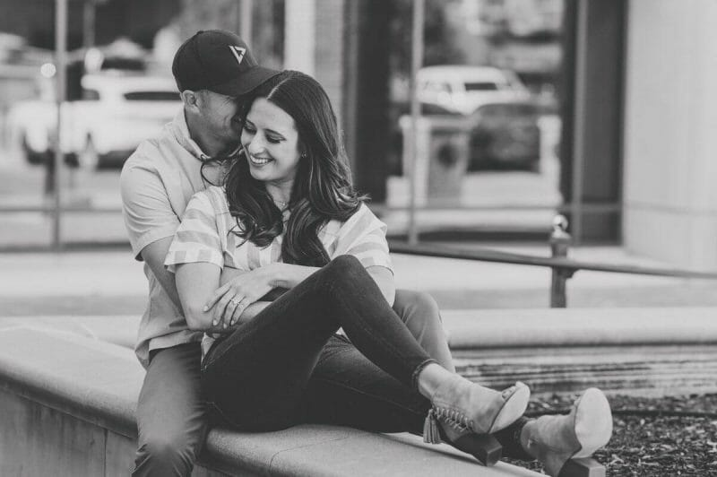 black and white photo of couple on Country Club plaza in KC