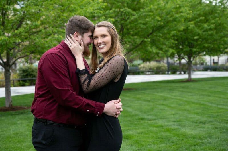 couple smiling in lawn of Kiener Plaza