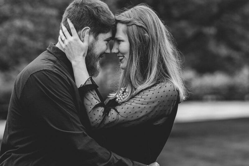 black and white of couple with heads together