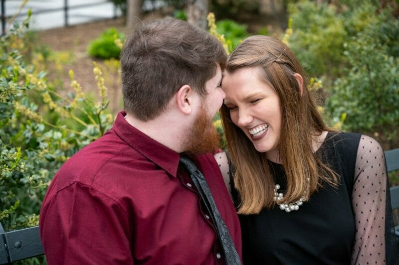girl laughing during engagement shoot in St. Louis