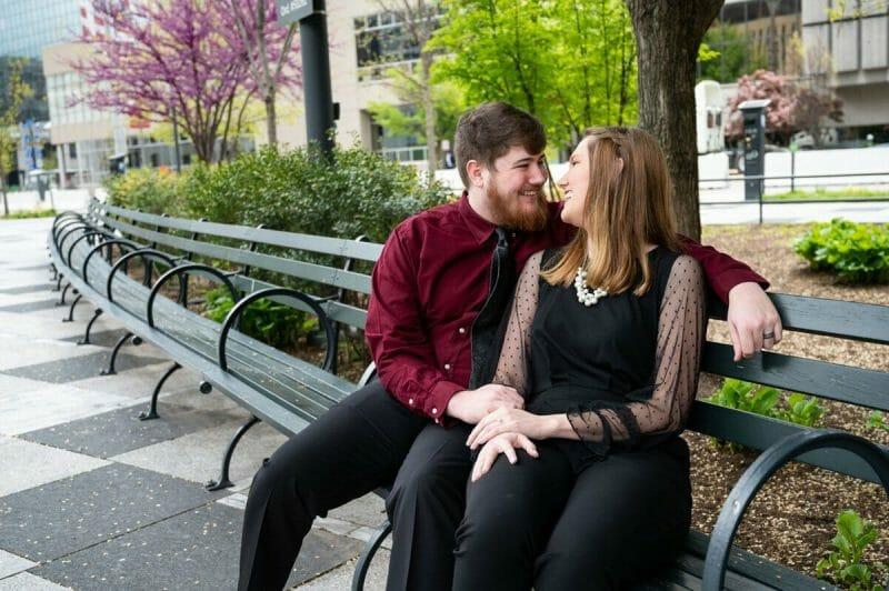 couple sitting on bench at Kiener Plaza Park