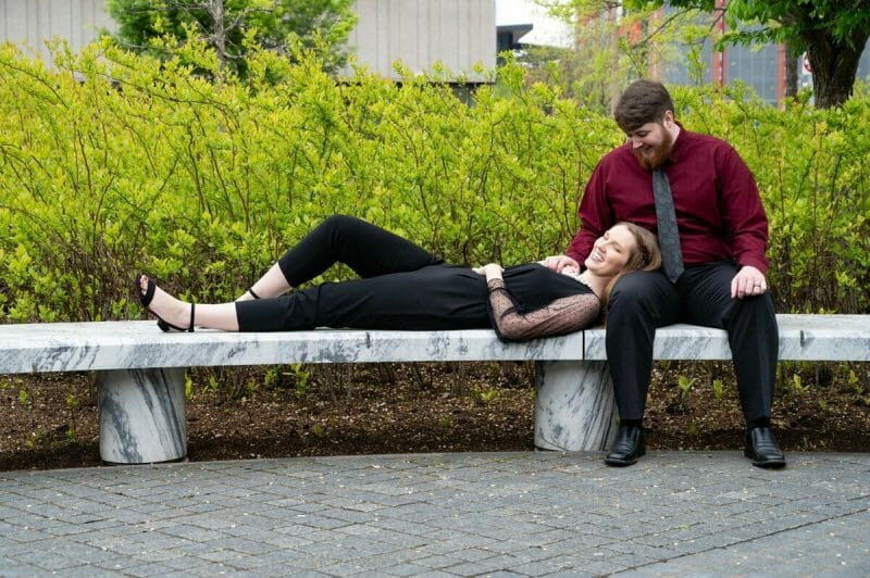 girl laying down on guy at Kiener Plaza