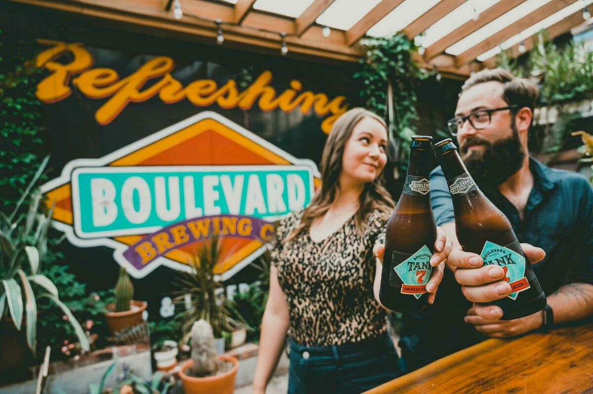 engagement photos in front of Boulevard Brewing sign in KC