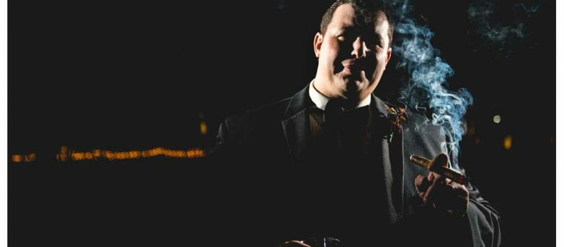 dramatic groom portrait with cigar