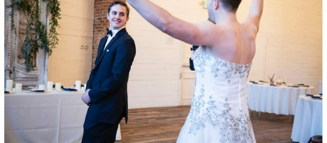 surprise first look with groomsmen in dress