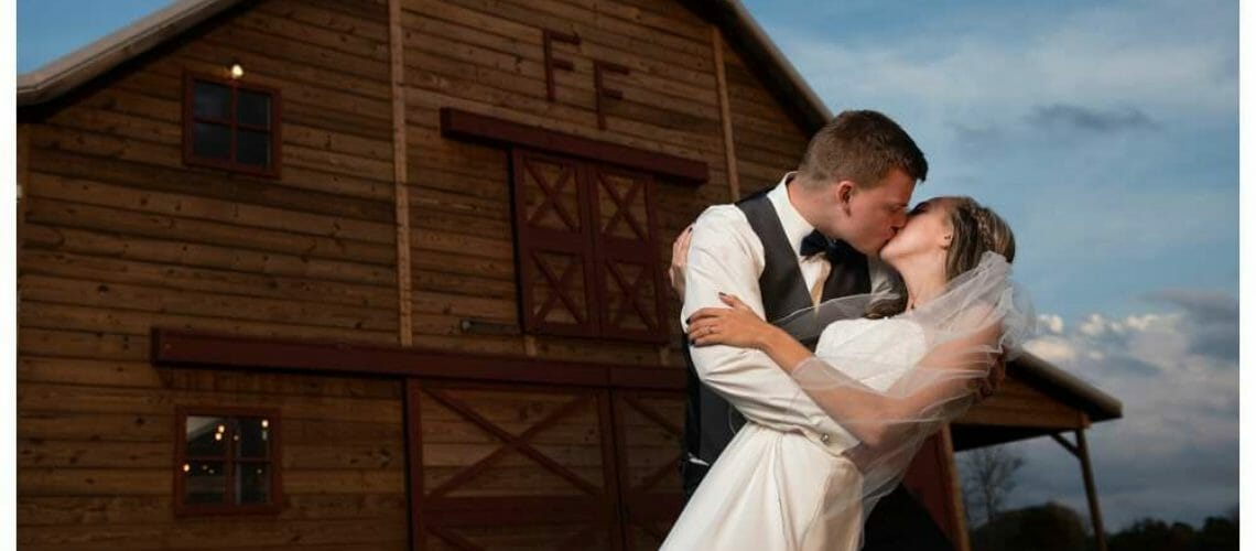 wedding photo in front of Fritchie Farms