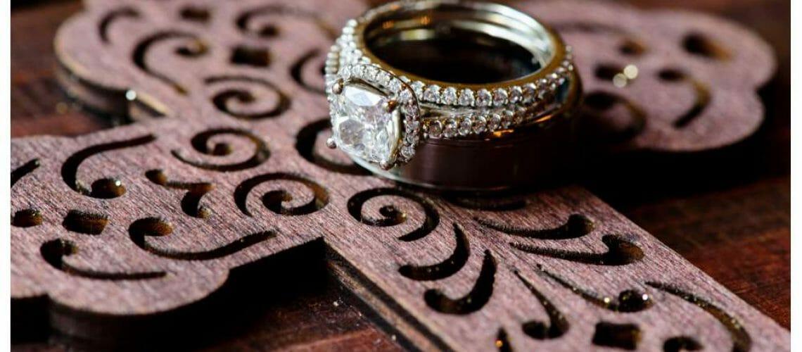 Wedding rings on custom ring box with cross